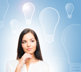 A successful and beautiful businesswoman and bulbs