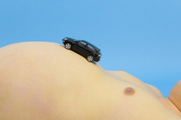 stomach of metabolic syndrome man with toy car on it