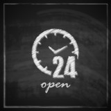 open 24 hours a day sign on blackboard background.