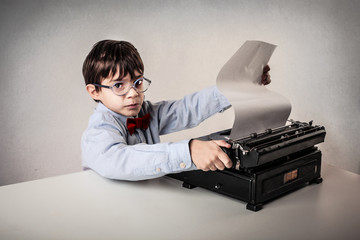kid with typing machine