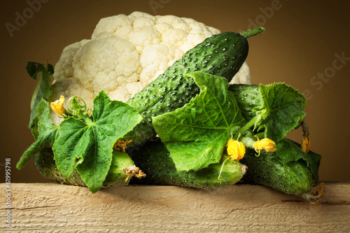 Organic cucumber and cauliflower with leaves
