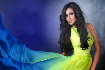 luxurious beautiful brunette woman in evening dress