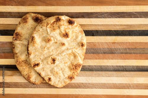 Foto op Canvas Brood Crisp crusty naan whole grain flatbread