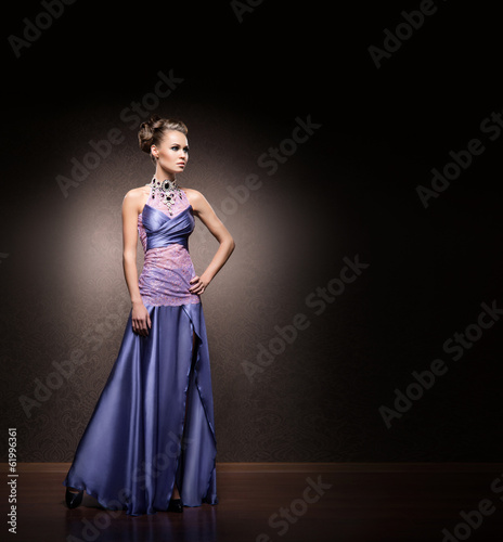 A beautiful woman in a glamour dress in a studio