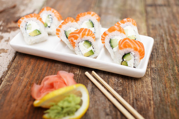 A plate with a luxury sushi set on a table