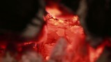 Glowing hot wood embers on closeup