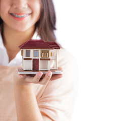 Woman holding little house
