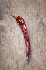 dried red chilli pepper on wood table