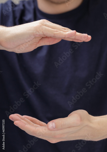 adult man hands to hold something