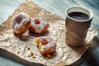 Closeup of hot coffee and donuts