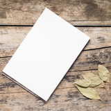 Blank White  Sketchpad with bay leaf on wooden background