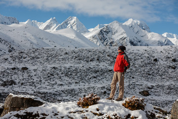 Hiker posing in Himalayas in front of big mountains