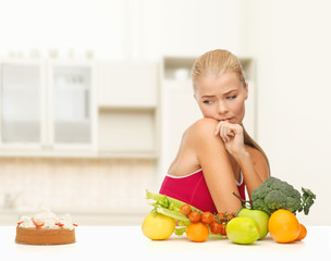 doubting woman with fruits and pie