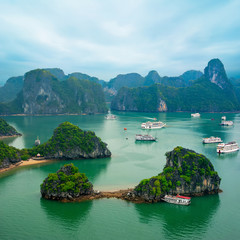 Tourist junks among limestone rocks. Ha Long Bay, Vietnam