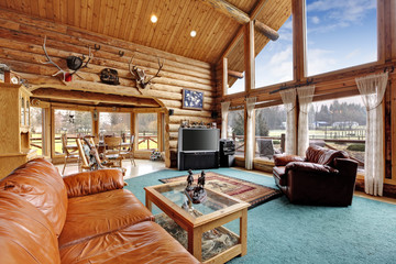 Large living room with diining area in log cabin house