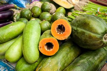 Papaya and fresh organic vegetables and fruits at asian market