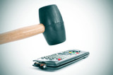 broking a remote control with a hammer