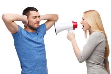 girlfriend screaming though megaphone at boyfriend