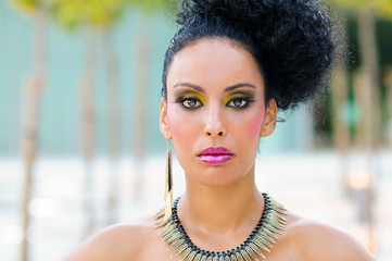 Young black woman, model of fashion with fantasy make-up
