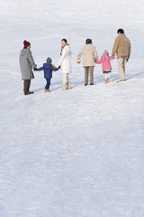 three-generation family on snow