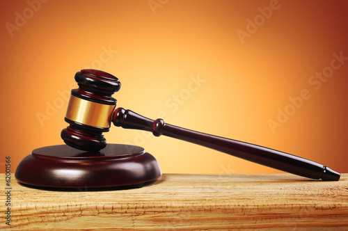 Judge gavel and soundboard over gold background