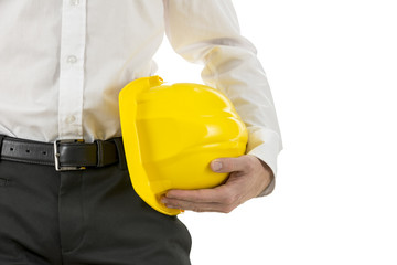 Engineer carrying a yellow hardhat under his arm