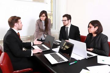 Business people having board meeting