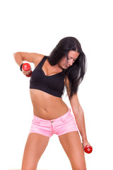 sexy woman in sports with dumbbells exercising