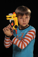 A boy with a toy gun depicts a special agent.