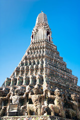 Wat Arun or Temple of Dawn over blue sky. Thailand