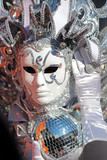 Silver mask with light twinkles at Carnival of Venice