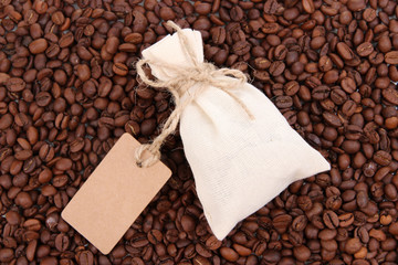 Sack with coffee on coffee beans background