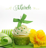 Happy March Spring theme cupcake with green yellow decorations.