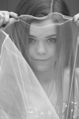 teen girl behind a veil