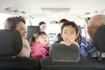 three-generation family enjoy driving
