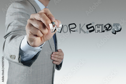 businessman hand drawing design word WORKSHOP as concept
