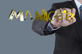 businessman hand drawing design graphic word MANAGER as concept