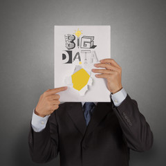 businessman hand show book of  BIG DATA as concept