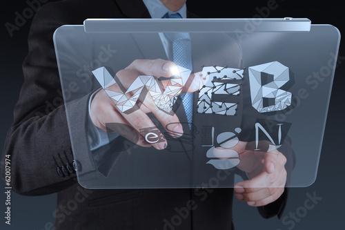 businessman hand working with tablet computer show WEB DESIGN wo
