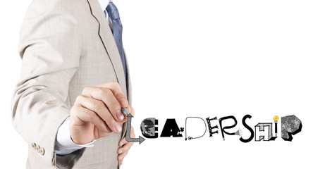 businessman hand drawing design grphic word LEADERSHIP as concep
