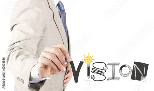 businessman hand drawing VISION design word as concept