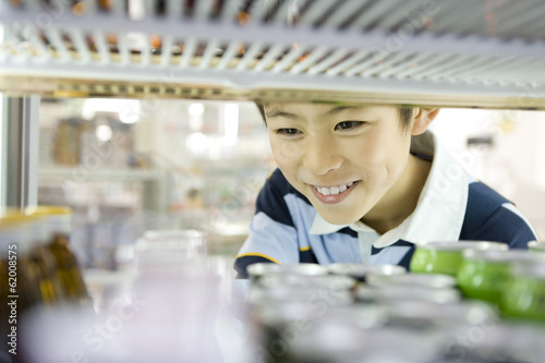 boy choosing drink at convenience store