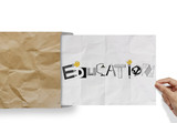 hand pulling crumpled paper from envelope with design word EDUCA