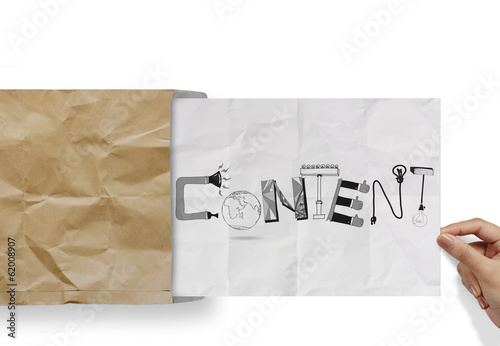 hand pulling crumpled paper from envelope with design word CONTE