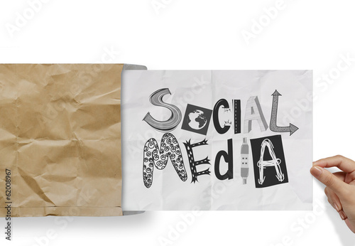 hand pulling crumpled paper from envelope with design word SOCIA