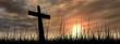 Leinwandbild Motiv Black cross in grass at sunset