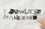 businessman hand drawing design word KNOWLEDGE MANAGEMENT on cru