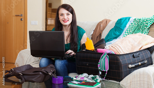 brunette woman reserving hotel in internet