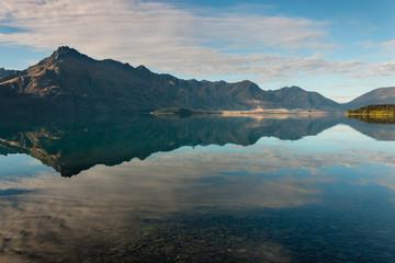 mountains reflecting in lake Wakatipu, New Zealand