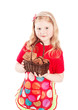 Beautiful little girl holding cookies isolated on white
